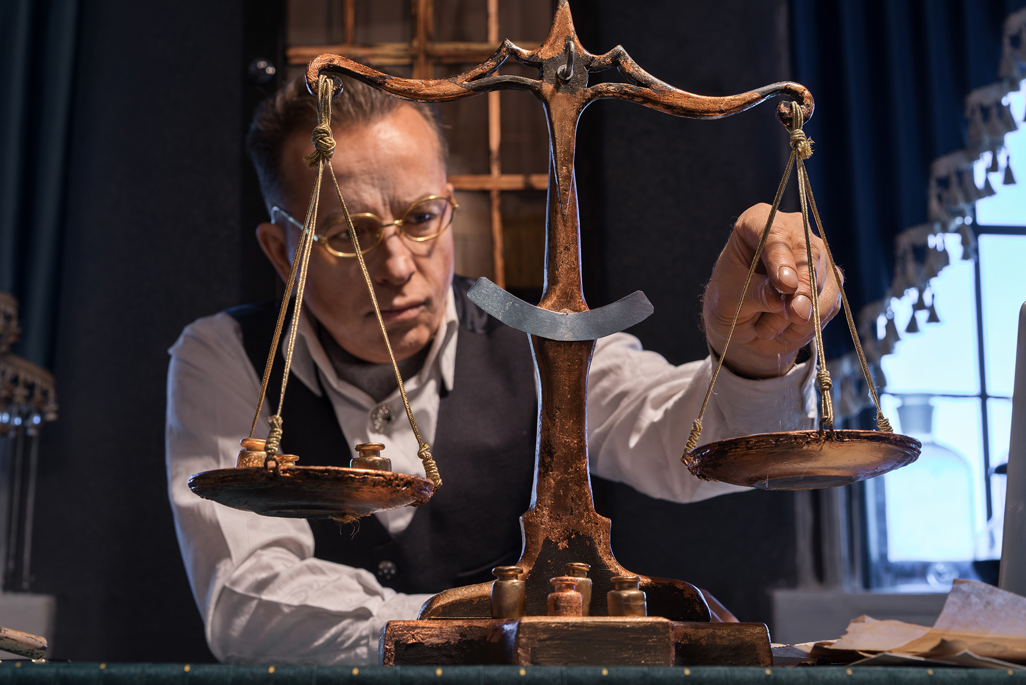 Scientist weighs on an old pharmacy scales